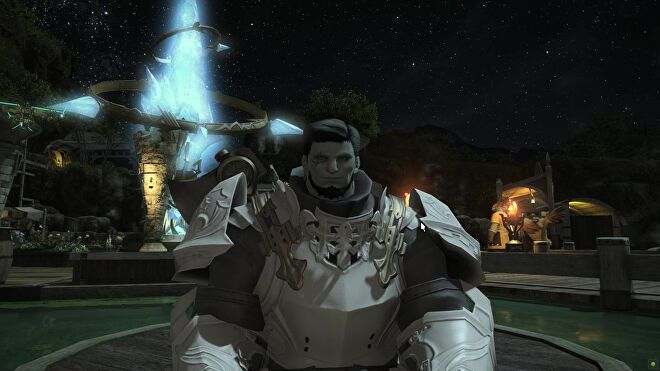 An image from Final Fantasy XIV which shows Shadow Hulk smiling for the camera, with a big blue crystal swirling behind him in the background.