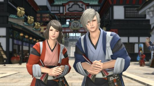 Two Final Fantasy XIV players face the camera with a welcoming look.