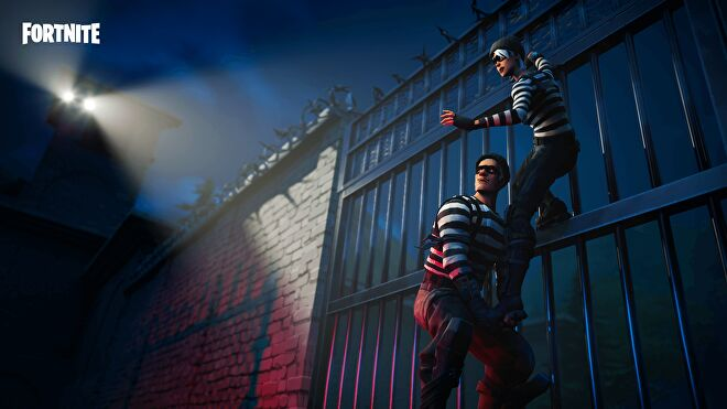 Two Fortnite characters dressed as robbers climbing over a prison wall.