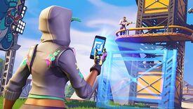 A Fortnite character uses their phone to edit a tower another character is standing on.
