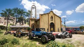 Different types of cars parked in front of a village church in rural Mexico in Forza Horizon 5