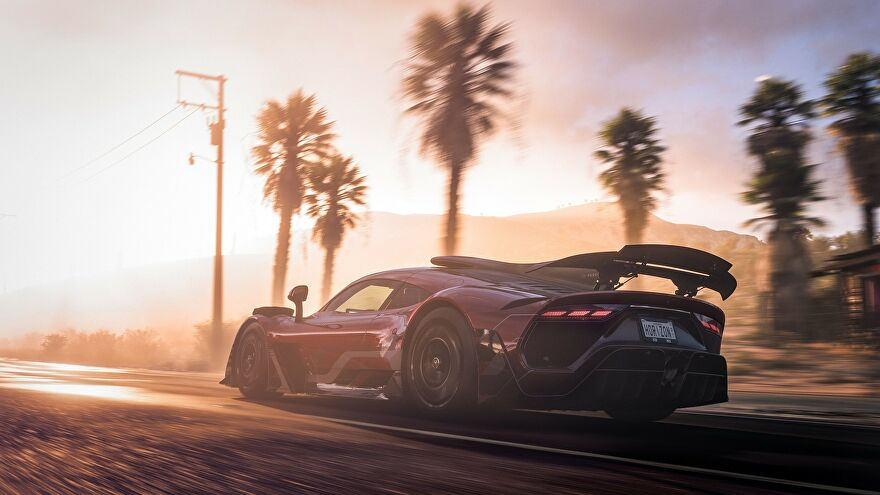A car driving into the sunset in Forza Horizon 5