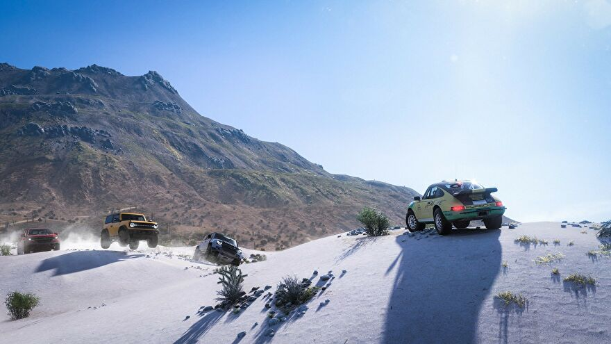 A car parks on a snowy mountain top in Forza Horizon 5