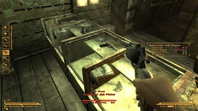 A gun is being pointed at a table full of other guns in the FPS Weapon Wheel mod for Fallout: New Vegas