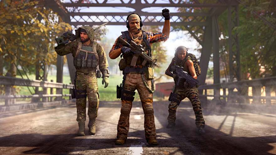 An image of Ghost Recon Frontline showing three people with guns. As per.