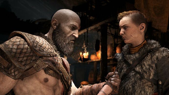 Kratos holds his son's arm in a screenshot from God of War's PC edition.