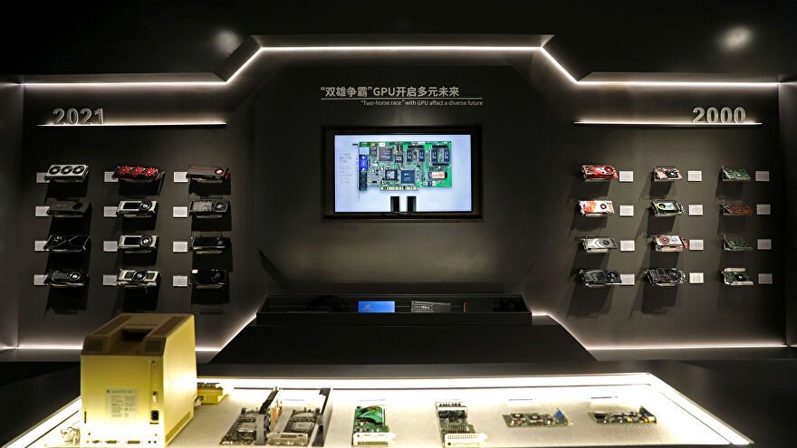 A photo of the GPU History Museum with graphics cards on the wall.