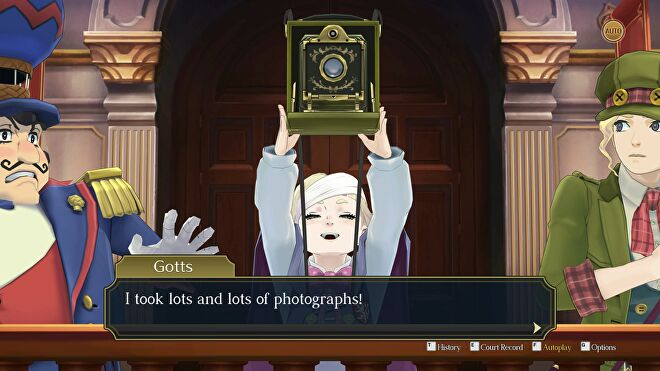 A young boy holds up a camera in the witness stand in The Great Ace Attorney Chronicles