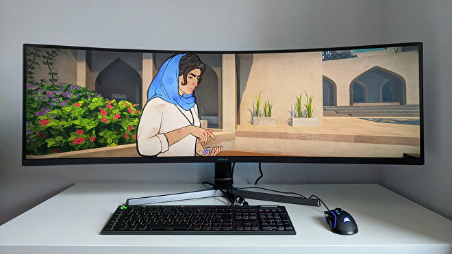 A photo of an ultrawide gaming monitor running Heaven's Vault