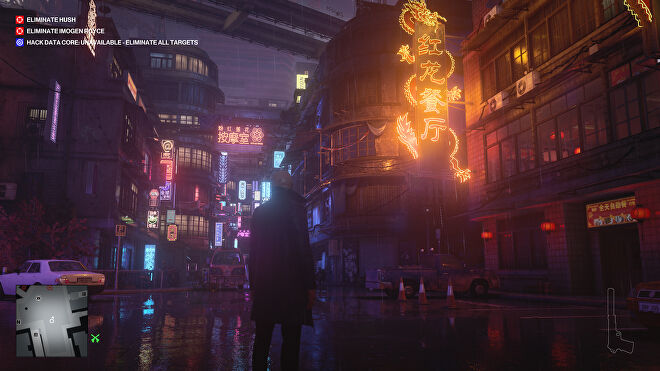 A screenshot of the Chongquin level of Hitman, a narrow street lit by bright neon signs.