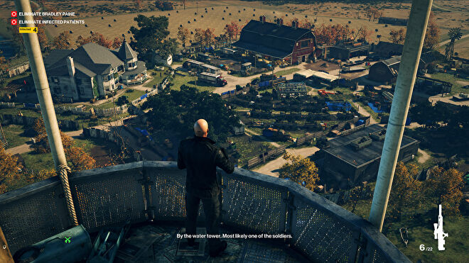 Agent 47 stands in a tower overlooking a slightly sus looking farm in the Colorado level. It is evident that he is in a sniper's nest.