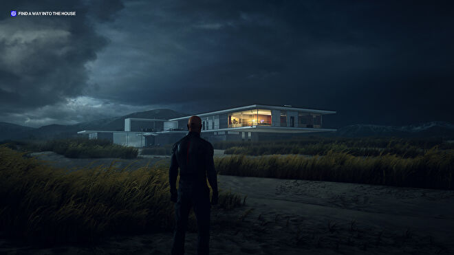A screenshot of Ian Hitman standing on the beach at Hawke's Beach, looking towards the modern seaside home, at night.