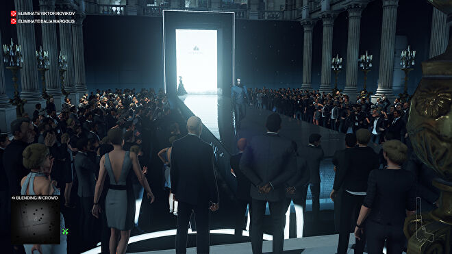 A screenshot of the Paris level, showing Ian Hitman standing at the end of a long, sleek, fashion runway, watching from the crowd as models walk down.
