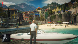 A screenshot showing the Sapienza level of Hitman 2. Ian Hitman is standing on a jetty by a speedboat, looking at a lovely little beach and a quiet town in the sunshine.