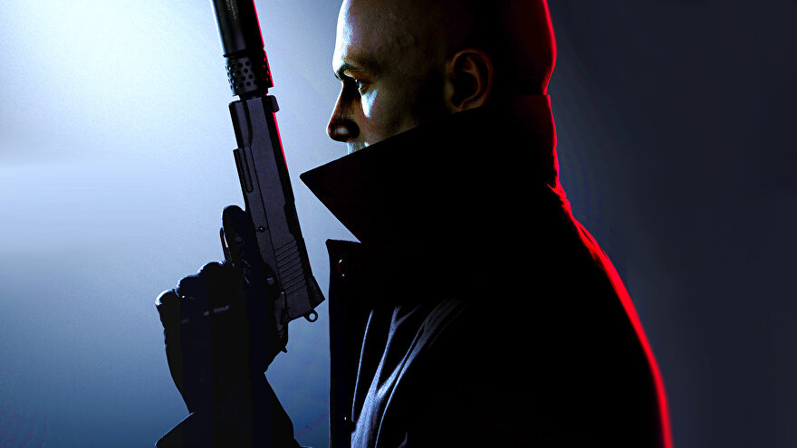 Agent 47 standing in profile holding a gun in Hitman 3