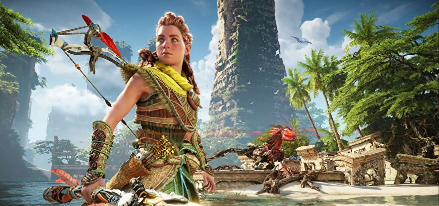 A screenshot of Horizon Forbidden West showing protagonist Aloy posing in front of a tropical water scene, with a robot dinosaur looking menacing on a nearby shore.