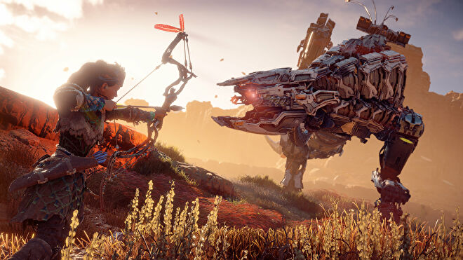 Aloy prepares to fire an arrow at the Thunderjaw bearing down on her in Horizon Zero Dawn.
