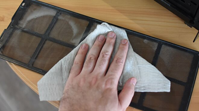 An image of a PC case dust filter being cleaned.