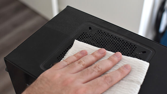 An image of a PC case being cleaned of dust.