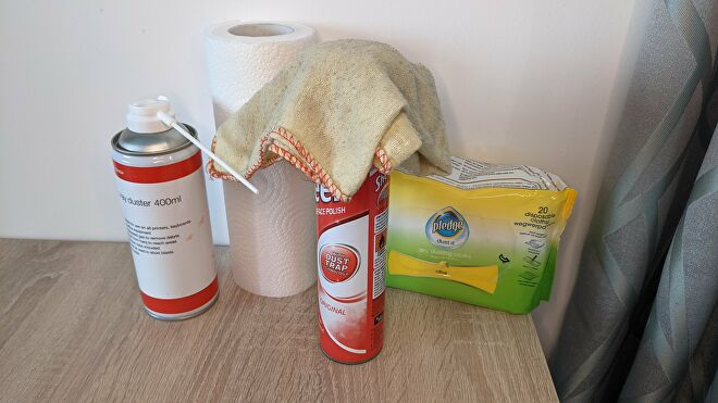 An image of PC cleaning equipment, including cloths, polish and a compressed air can.