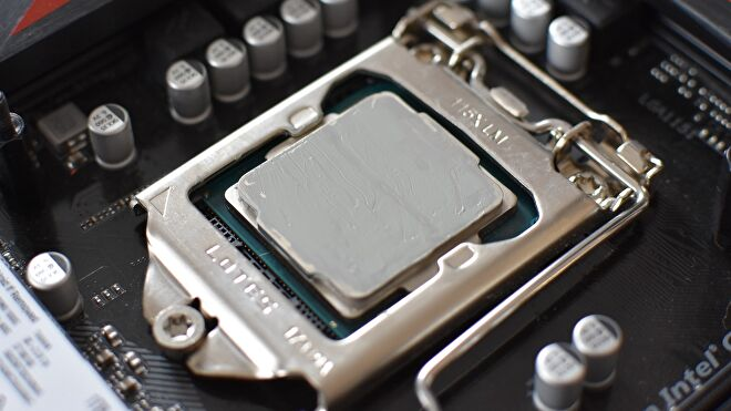 An Intel CPU covered in a thin layer of thermal paste.