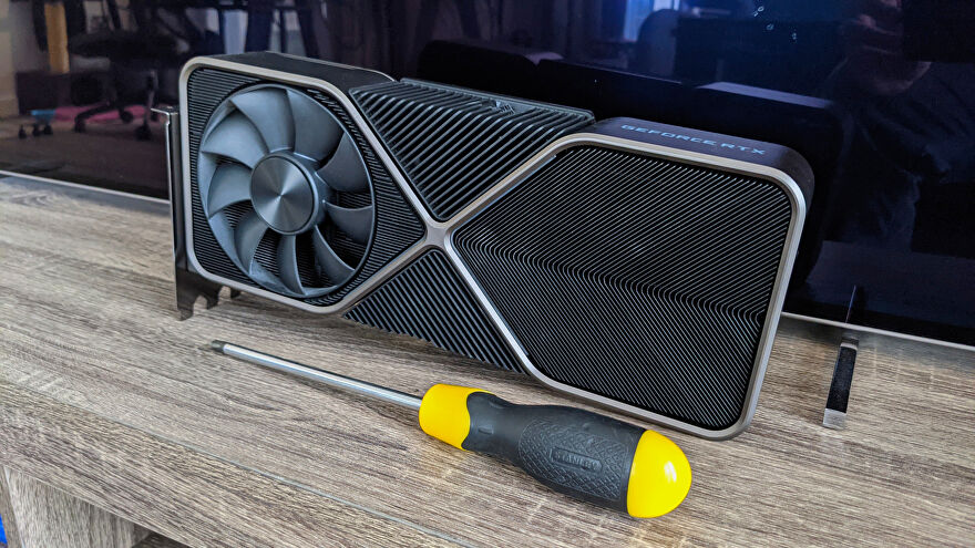 An Nvidia GeForce RTX 3090 Founders Edition on a table, next to a screwdriver.