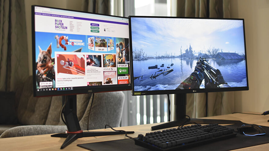 Two PC monitors on a desk, one showing Metro Exodus and one showing RPS in a browser.