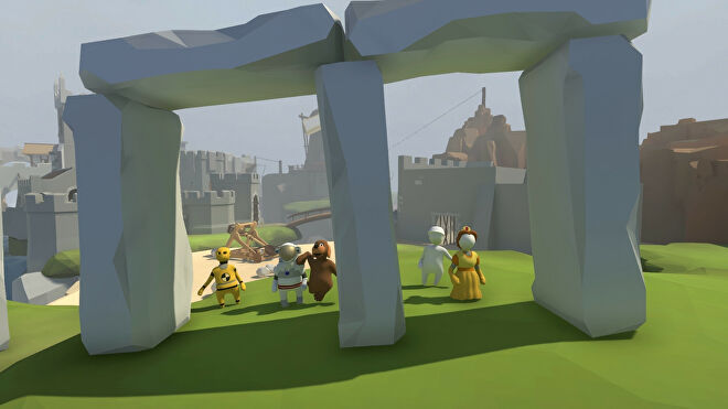 A group of white, doughy player characters walking across a grassy plain under a large stone gateway in Human Fall Flat