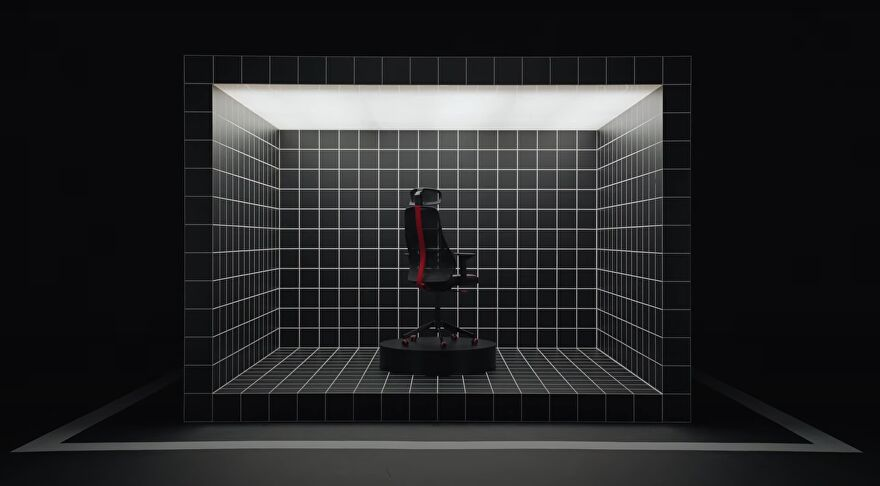 A still from Ikea's video introducing their range of gaming furniture, showing a gaming chair sat inside a cube covered in grid lines.