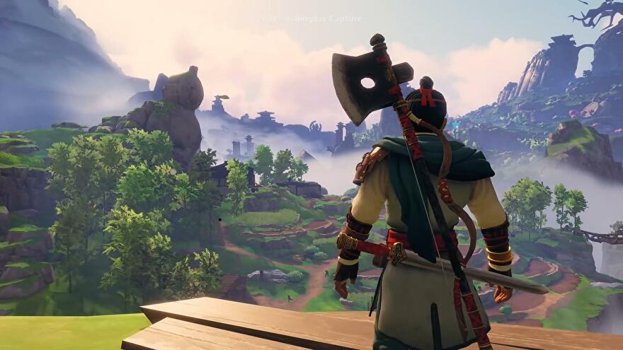 Immortals Fenyx Rising Eastern Realm DLC - Ku looks out over a valley, carrying an axe and sword.