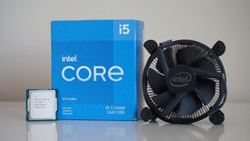 Intel's Core i5-11400F processor next to its box and bundled cooler
