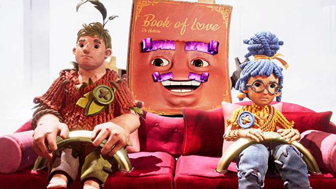 The playable characters of It Takes Two sitting on a sofa, Cody on the left and May on the right, with the Book Of Love Dr. Hakim in the middle of them