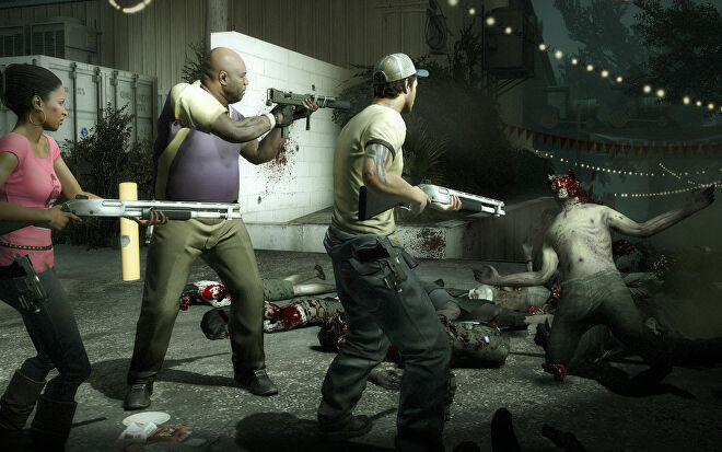 Three characters aim their guns at a zombie on the floor in Left 4 Dead 2