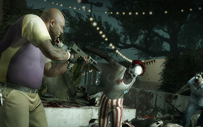 A player aims at a zombie clown that lunges at them in Left 4 Dead 2.