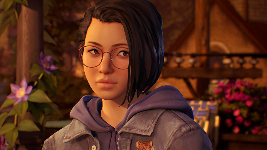 """A screenshot of Life Is Strange: True Colors showing protagonist Alex Chen, a young woman with the supernatural ability to """"experience, absorb and manipulate the strong emotions of others."""""""