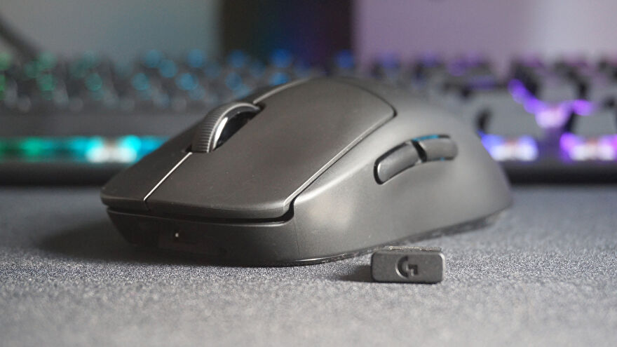 A photo of the Logitech G Pro Wireless mouse and its USB adapter