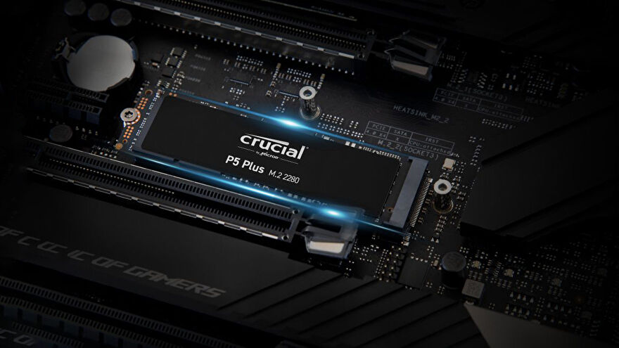 a photo of a crucial p5 plus nvme ssd on a computer motherboard, highlighted in blue light