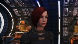 Commander Shepard stands facing the camera on the deck of the Normandy in Mass Effect, banks of cool orange computers behind her.