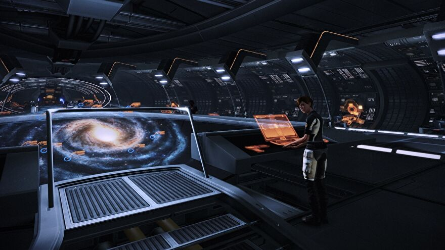 A first-person view of the CIC in Mass Effect 2. You can see the galaxy map and Yeoman Kelly.