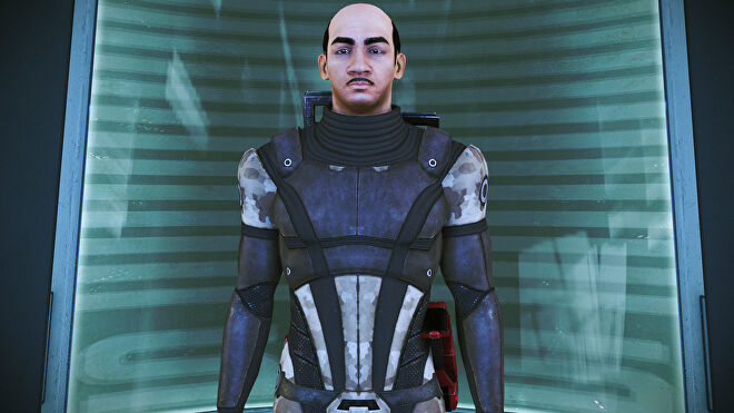 Commander Shepard from Mass Effect Legendary Edition waiting patiently in the elevator. Shepard also looks an awful lot like Hercule Poirot, as played by David Suchet.