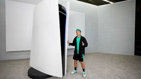 A man stands next to a 10ft tall PlayStation 5