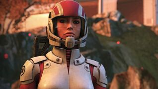 A close-up of a female Commander Shepard in a white and red space suit in Mass Effect