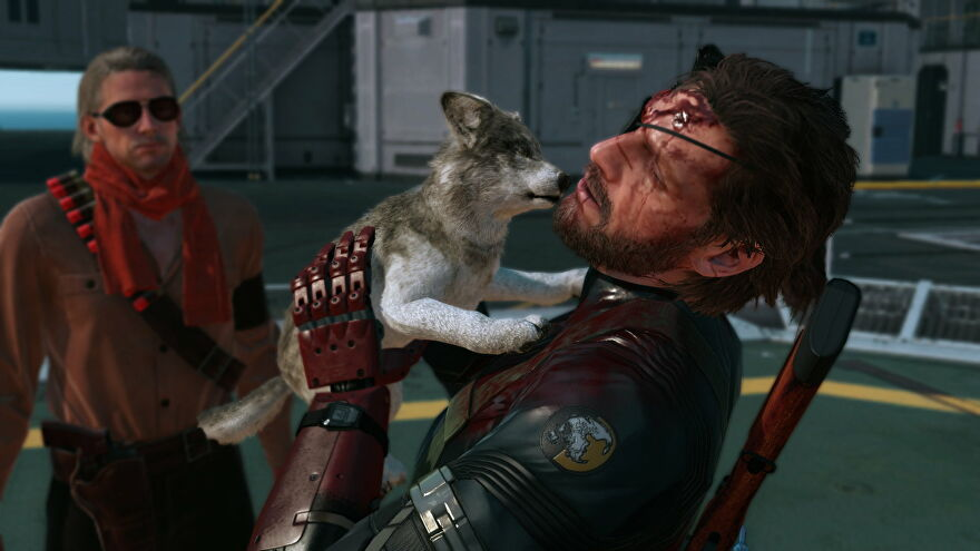 Venom Snake licked by a wolf puppy in a Metal Gear Solid V screenshot.