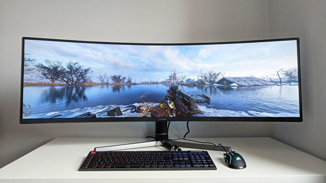 A photo of an ultrawide gaming monitor running Metro Exodus