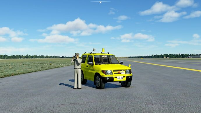 A screenshot of Microsoft Flight Simulator showing a yellow Mitsubushi car parked on a runway, with a Playmobil-looking fellow standing next to it, peering through binoculars.