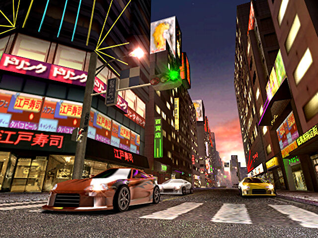 Cars lined up to race on city streets in a Midnight Club 2 screenshot.