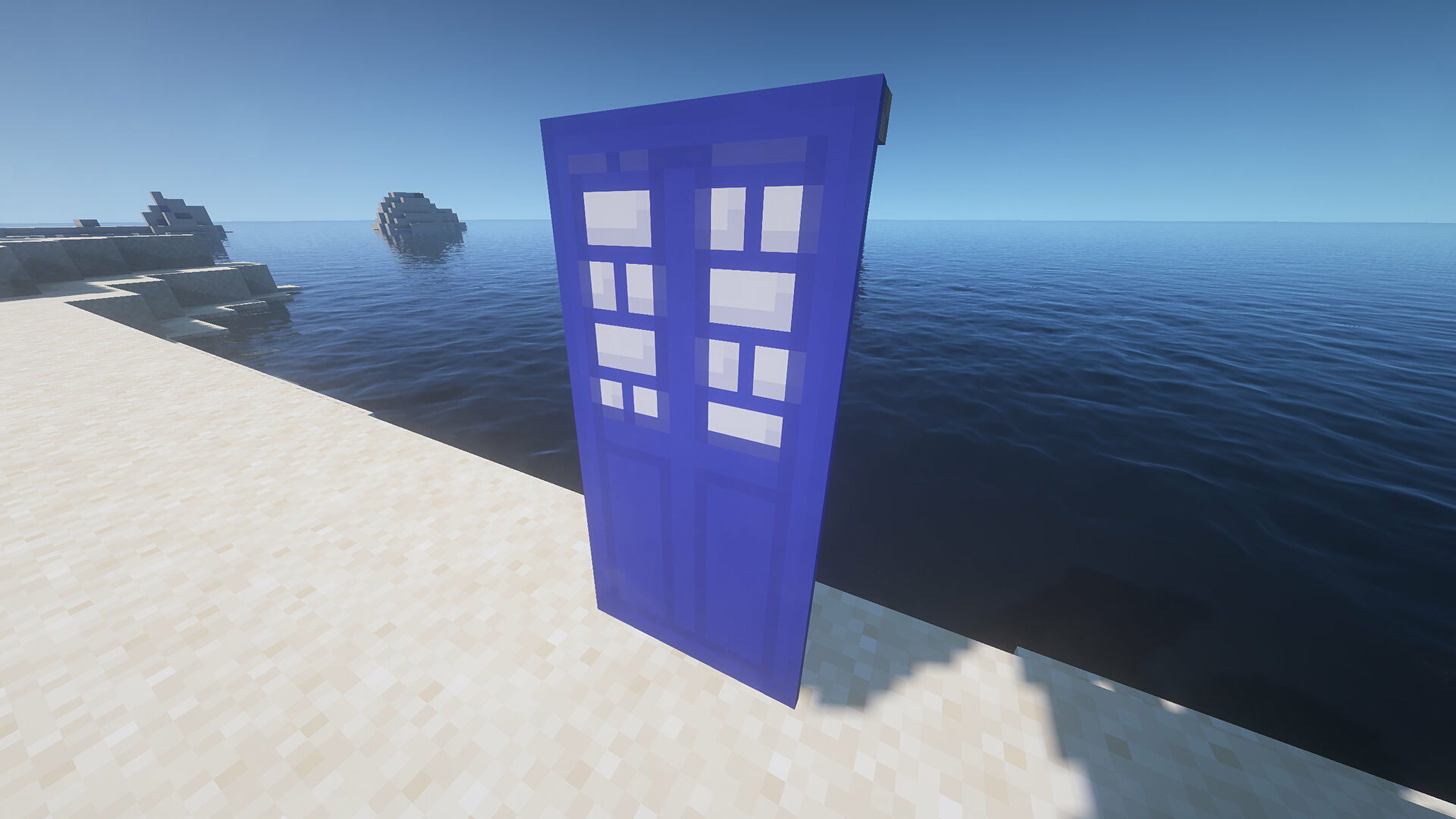 A TARDIS Banner in Minecraft, placed in the ground by the coast.
