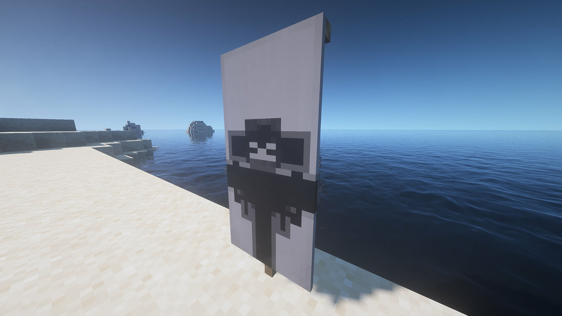 A planet Banner in Minecraft, placed in the ground by the coast.