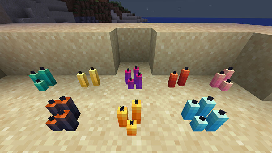 A Minecraft screenshot of an arrangement of Candles of different colours on a beach at night.