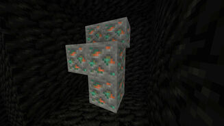 A Minecraft screenshot of a vein of Copper Ore, dug out and surrounded by Coal Blocks.